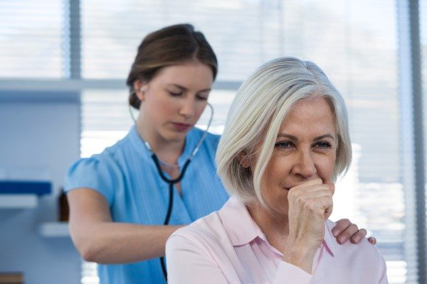 Woman Suffering from Shortness of Breath